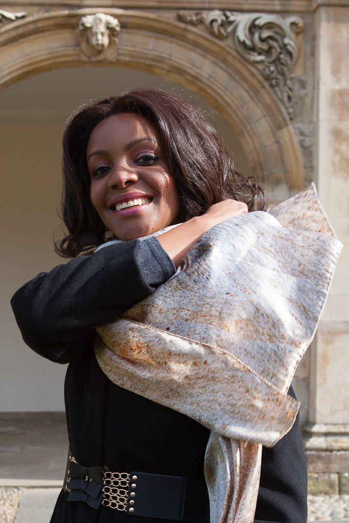 Mpule Kwelagobe wearing a Eucalyptus Tree silk scarf by Howard Guest outside the Pepys Library, Magdalene College