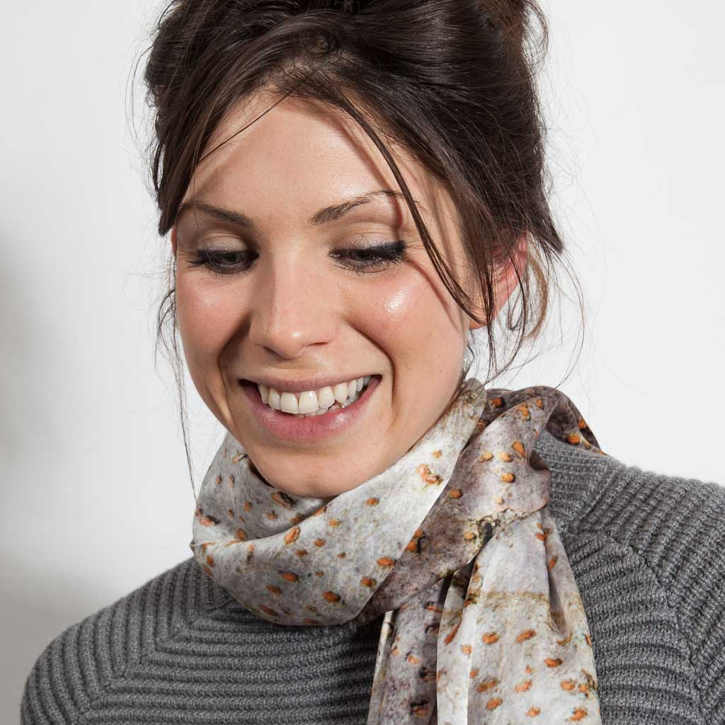 The Spur Leaf Silk Scarf worn with a grey jersey. Looking stylish and contemporary.
