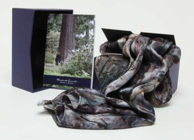 The 100% silk Black Pine Scarf with the box and pamphlet. Designed by Howard Guest and Made in Britain.