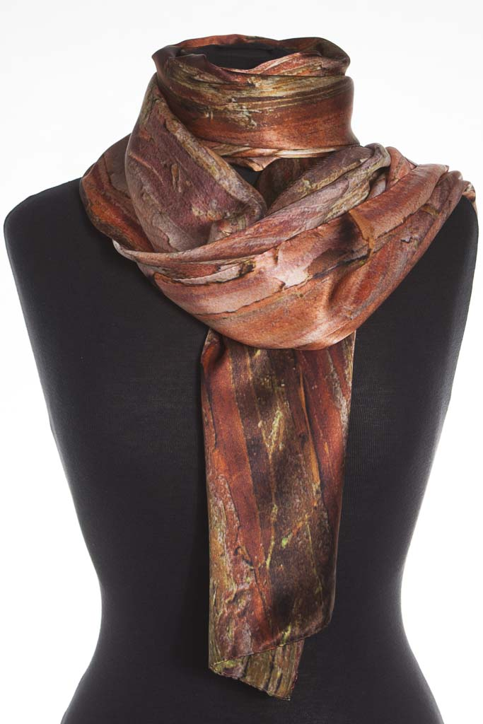 The Japanese Cypress Silk Scarf. Made in Britain from 100% satin silk by Howard Guest.  Glorious reds and browns, sophisticated and casual.