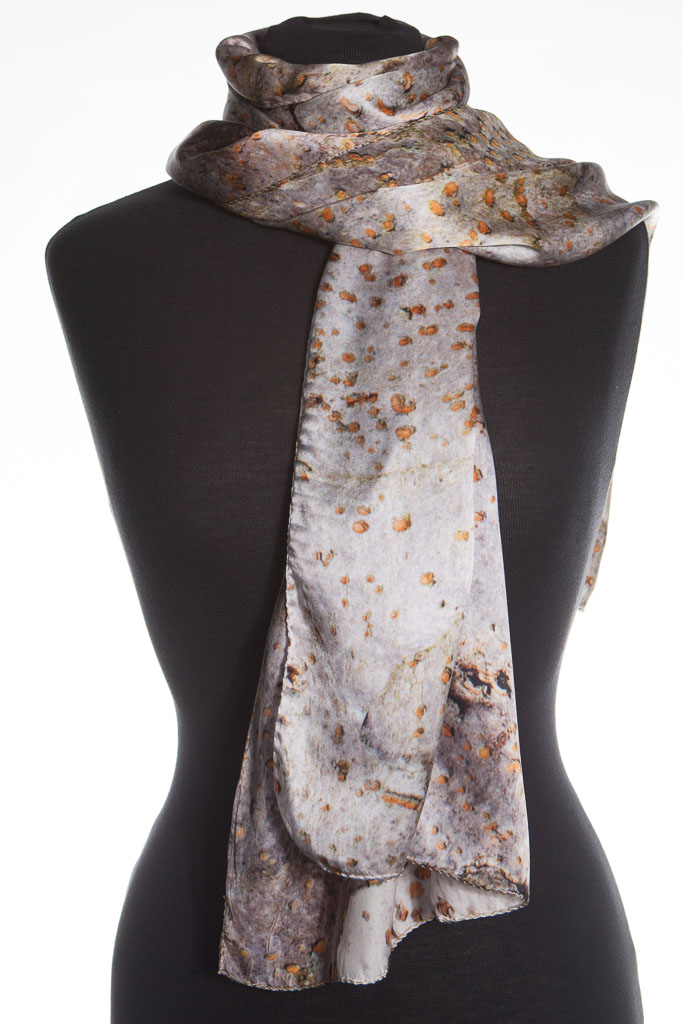 The Spur Leaf Silk Scarf by Howard Guest. Naturally elegant, the silvers and oranges shimmer with style.  A perfect accessory for  nights out. #HowardGuestSilks #scarf #silk #silver #grey #orange