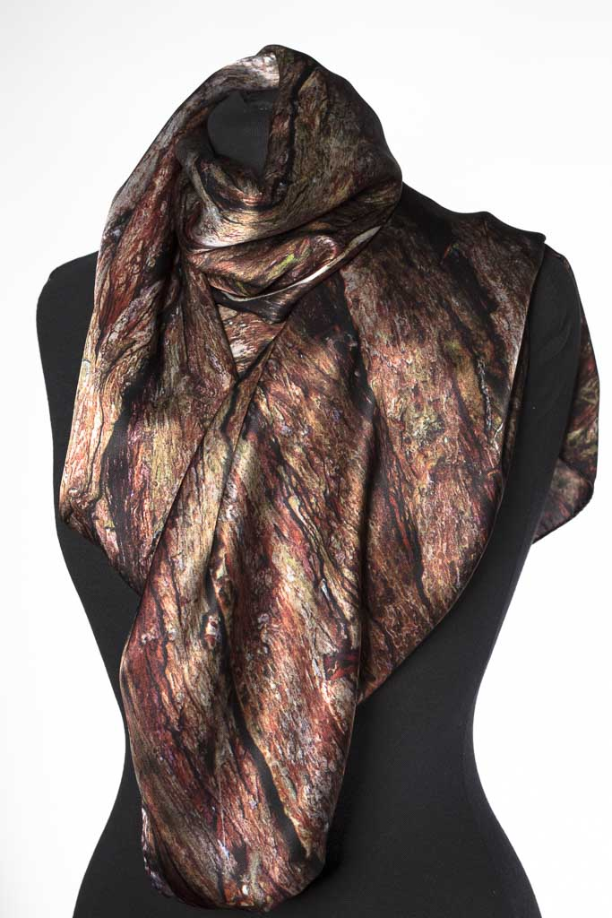 The Xu Zhimo Silk Scarf by Howard Guest. Created from a close-up of a willow that sits on the banks of the Cam at King\'s College. Reds, browns, abstract and sophisticated.